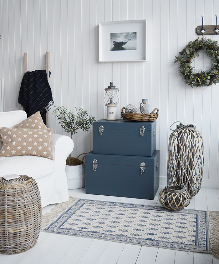 Set of Blue Newbury trunks as a set in the living room, storage furniture and side table for New England country, coastal and city home interiors design