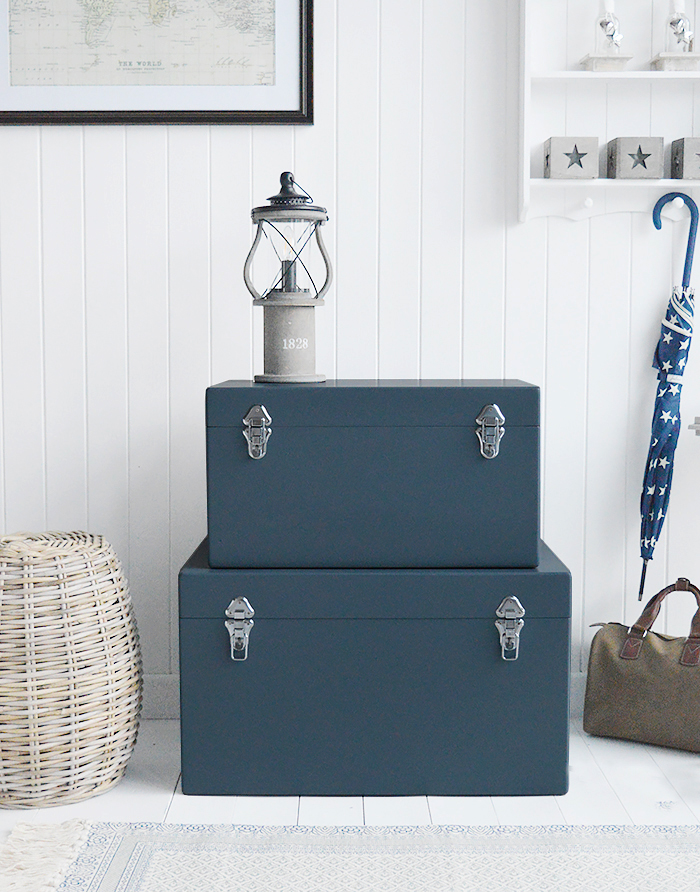 A set of two large different sized Newbury rectangle trunks in a luxurious dark blue grey colour in a matt finish with contrasting silver handles and clasps. The White Lighthouse New England Coastal and Country furniture and interiors. Bathroom, Living Room, Bedroom and Hallway Furniture for beautiful homes