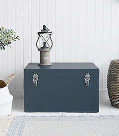 A set of two large different sized Newbury rectangle trunks in a luxurious dark blue grey colour in a matt finish with contrasting silver handles and clasps. The White Lighthouse New England Coastal and Country furniture and interiors. Bathroom, Living Room, Bedroom and Hallway Furniture for beautiful homes hallway storage bench