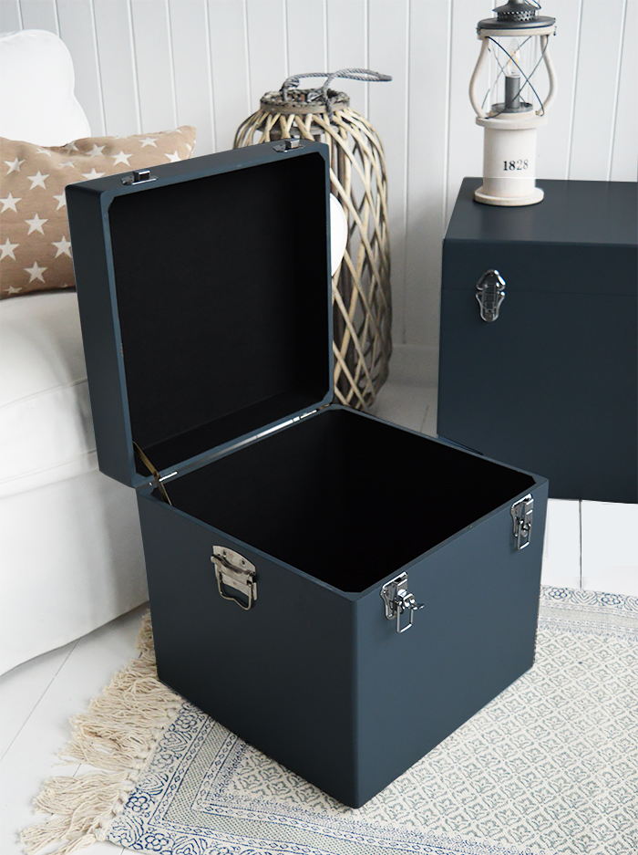 A set of two large different sized Newbury square trunks in a luxurious dark blue grey colour in a matt finish with contrasting silver handles and clasps. The White Lighthouse New England Coastal and Country furniture and interiors. Bathroom, Living Room, Bedroom and Hallway Furniture for beautiful homes