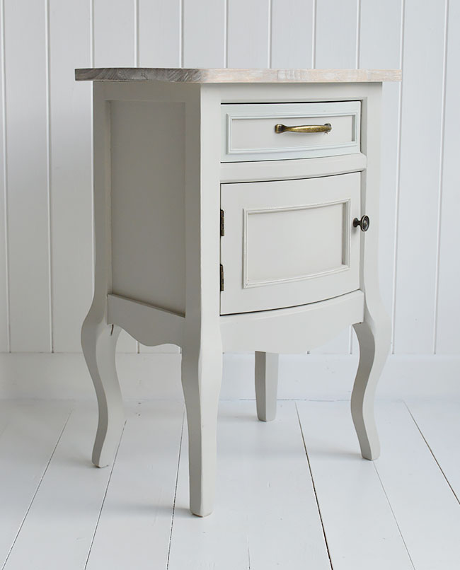 Grey bedroom furniture. Bedside table with cupboard and drawer
