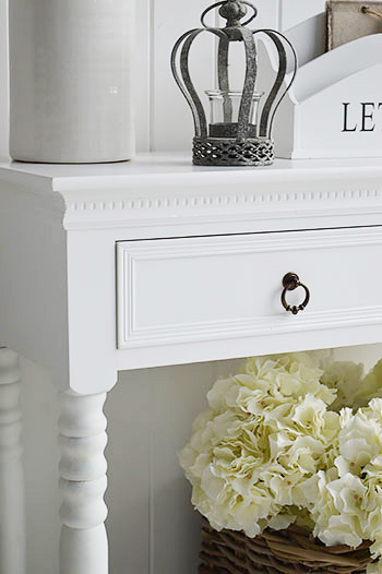 Close up image of white hallway table