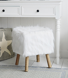 The Woodstock white faux fur sheekskin stool with a dressing table for white furniture