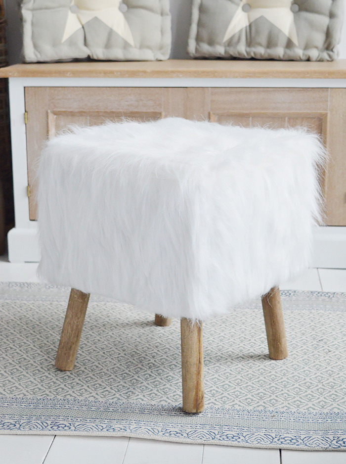 The Woodstock square white faux sheepskin fur stool with four contrasting legs in a rich coloured wood. Inspired by the laid back style of New England living in the country, by the coast and in the city, our beautiful Woodstock white foot stool adds warmth and texture to a room while offering extra seating and a comfortable place to rest your feet.