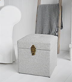 The Kittery small large storage trunk in grey easy to clean fabric and robust antique brass clasps.  Ideal as a sturdy storage seat in the hall, blanket box in the bedroom or coffee table in the living room.  The padded top offers comfortable seating with plenty of storage inside.