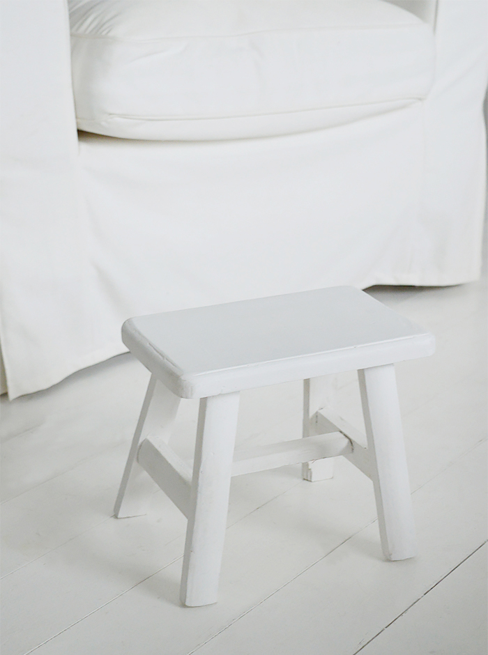 rustic handmade Nantucket white milking stool made from reclaimed wood. A versatile piece for furniture for coastal and country interior designs
