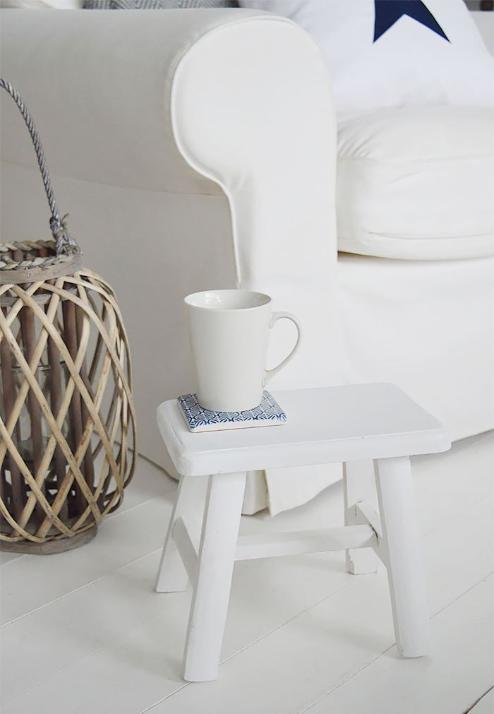 rustic handmade Nantucket white milking stool made from reclaimed wood. A versatile piece for furniture for coastal and country interiors  and homes