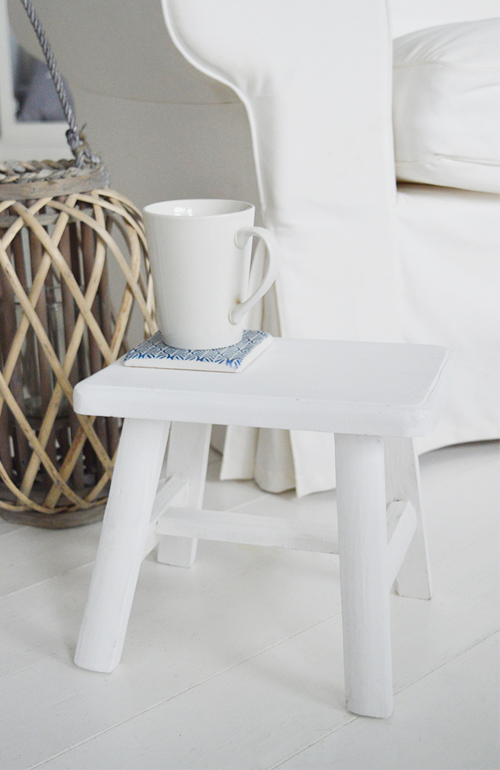 rustic handmade Nantucket white milking stool made from reclaimed wood. A versatile piece for furniture for coastal and country interiors