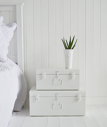 Nantucket white metal vintage suitcase trunks as bedside table