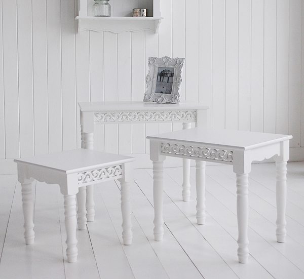 Ghows the deiiferent sizes of the white nest of tables