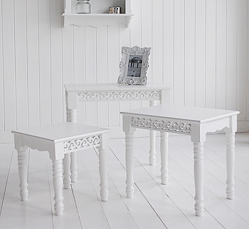 the white nest of tables can be used separately throughout different rooms in your home