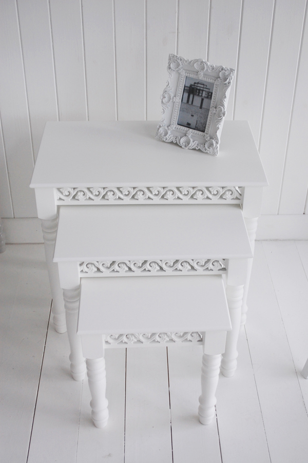 Images shows the white nest of tables from abive when together