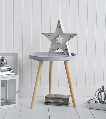 Grey tripod table for bathroom furniture