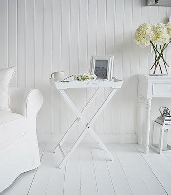 A white butler tray side table. The White Lighthouse