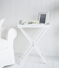 White furniture butler tray table. The tray table makes an excellent lamp table when space is at a minimum