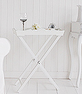 White butler tray table for halls. The tray table makes an excellent small console or lamp table when space is at a minimum