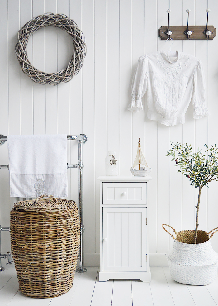 Maine white bathroom cabinet. White Furniture for storage with a cupboard and drawer. How to decorate and furnish a bathroom for homes by the sea