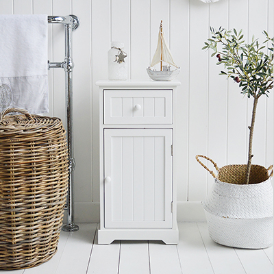 The Maine white bathroom cabinet with a drawer and a shelved cupboard.