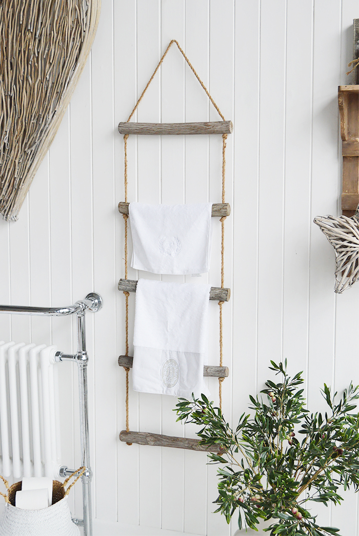 A rope ladder with driftwood effect rungs to hang towels, throws or blakets for a nautical coastal styled room - towel rail. from The White Lighthouse Furniture , New England interiors and furniture for the hallway, living room, bedroom and bathroom