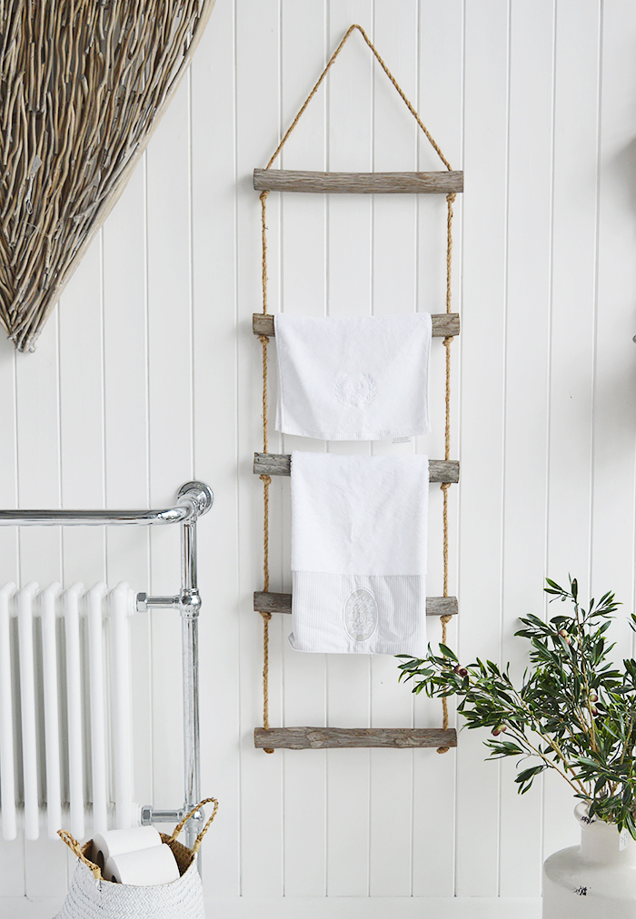 A rope ladder with driftwood effect rungs to hang towels, throws or blankets for a nautical coastal styled bathroom. from The White Lighthouse Furniture , New England interiors and furniture for the hallway, living room, bedroom and bathroom