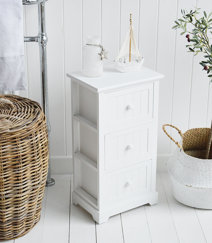 Maine Three drawer white bathroom cabinet. Storage furniture for the New England styled bathroom in country, coastal and city home interiors. Decorating a bathroom in nautical style