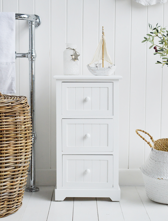 Maine Three drawer white bathroom cabinet. Storage furniture for the New England styled bathroom in country, coastal and city home interiors