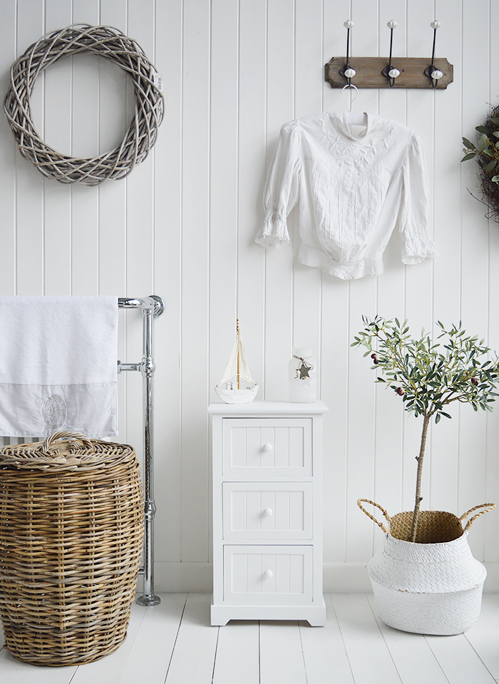 Maine Three drawer white bathroom cabinet. Storage furniture for the New England styled bathroom in country, coastal and city home interiors. Decorating ideas for a white bathroom