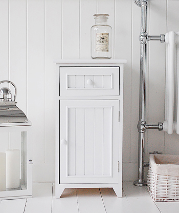 Maine white bathroom storage with a single cupboard and drawer