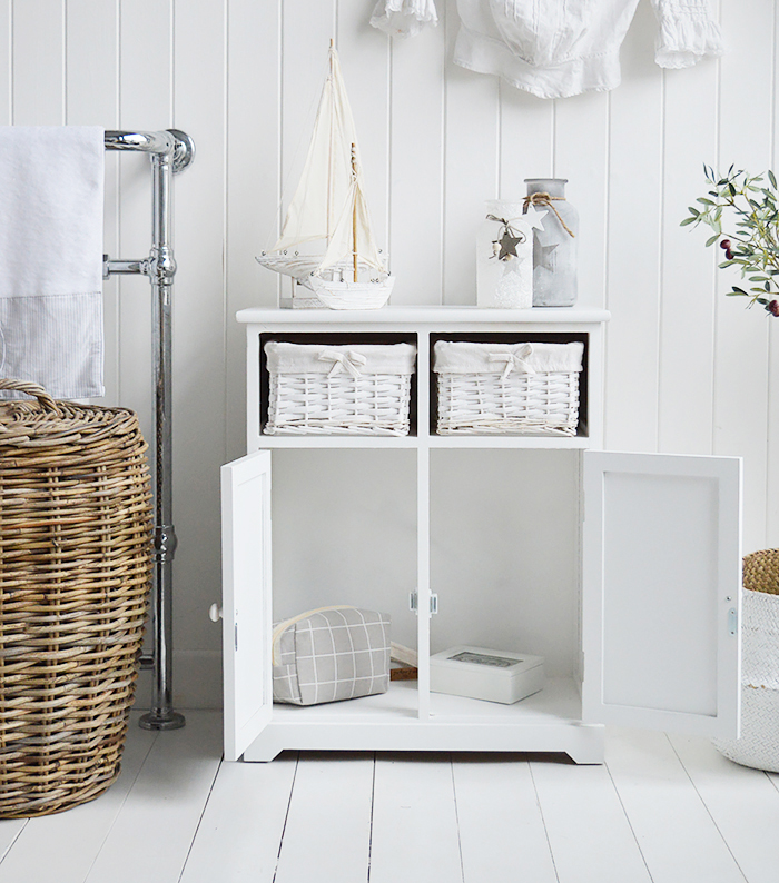 Maine white large bathroom cabinet. Furniture for storage in the bathroom for New England, country, coastal and city home interiors. Photograph shows the cabinet copen for storage solutions