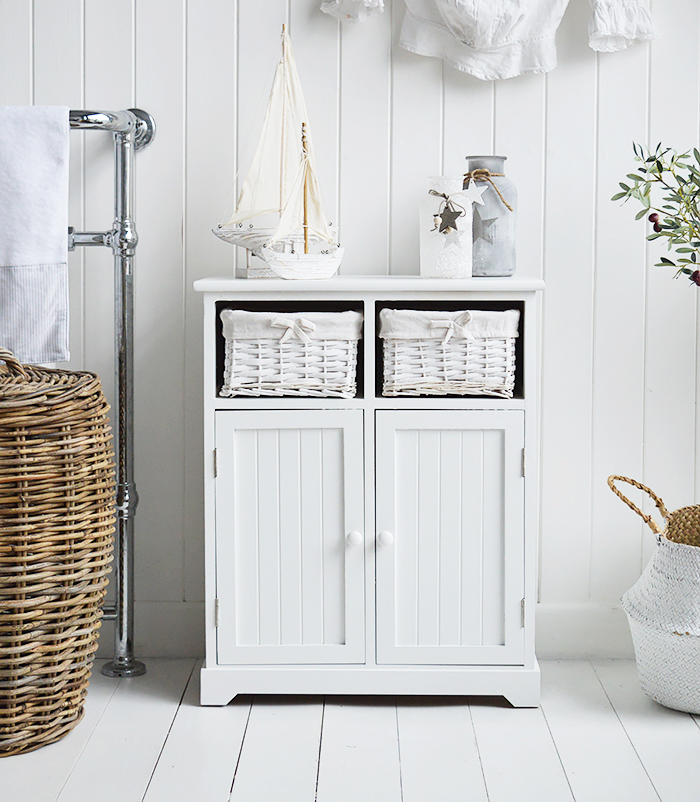 Maine white large bathroom cabinet. Furniture for storage in the bathroom for New England, country, coastal and city home interiors