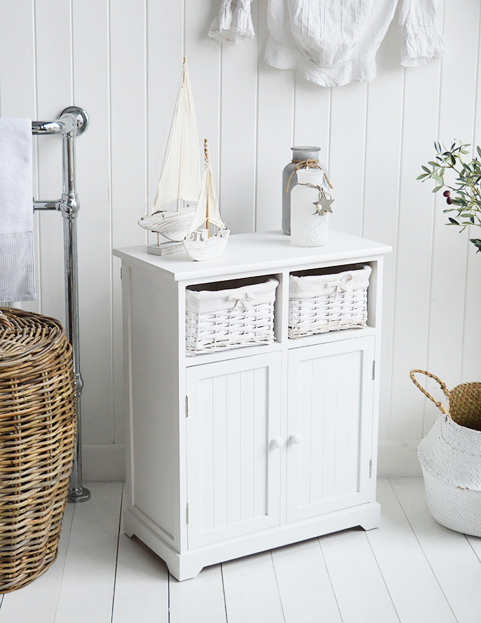 Maine white large bathroom cabinet. Furniture for storage in the bathroom for New England, country, coastal and city home interiors. Naurical bathroom design