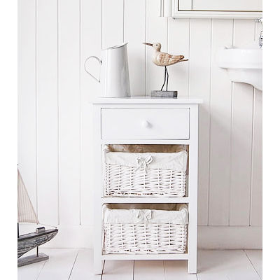 A white three drawer bathroom storage unit from The New Haven Range. The bottom two drawers are a white lined willow basket, the top drawer has a simple knob pull handle