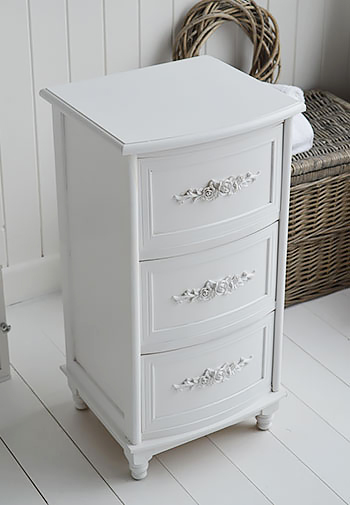 Pretty white bathroom drawers for a cottage style bathroom