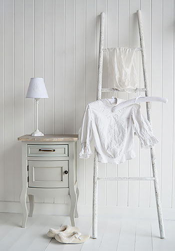 White clothes stand ladder