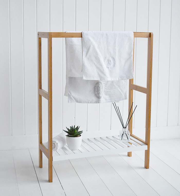 Freestanding wooden towel stand with white shelf