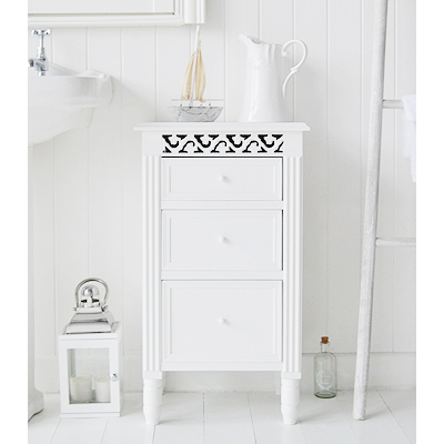 The Westport white bathroom cabinet with three drawers of differenent sizes to store toiletries and make up. A cut out design adds a touch of elegance to this bathroom cabinet