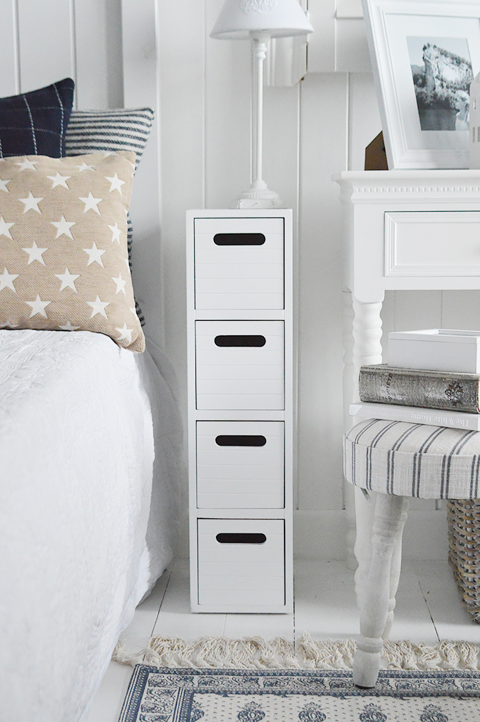 Dorset white very narrow slim white bedside table with 4 drawers for small white bedroom furniture at only 17cm wide. Perfect fi for such a small space besdie the bed