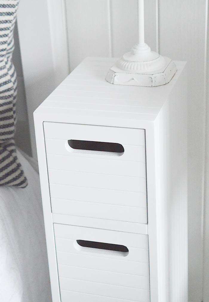 Dorset white very narrow slim white bedside table with 4 drawers for small white bedroom furniture at only 17cm wide. Photograph to show the cladding style finish