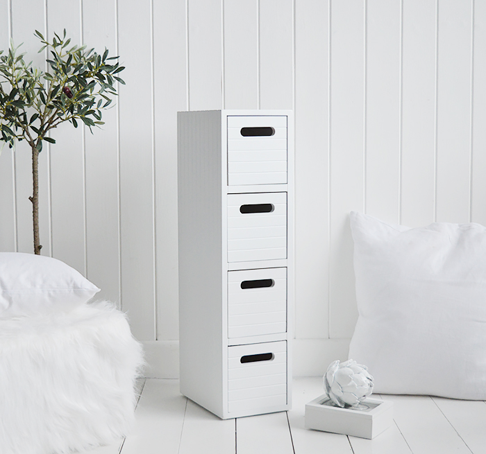 Dorset white very narrow slim white bedside table with 4 drawers for small white bedroom furniture at only 17cm wide. Photograph shows the side and top of the New England style cladding finish