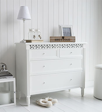 New England white chest of drawers. White bedroom furniture for all styles and interiors