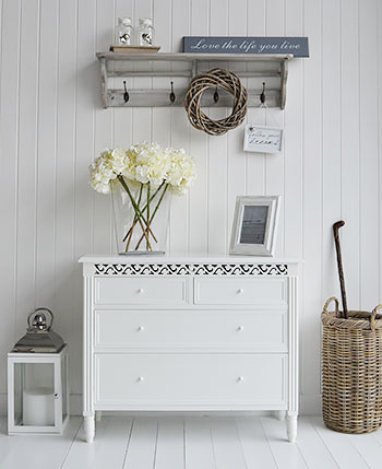 What about a White chest of drawers for an idea for hallway storage
