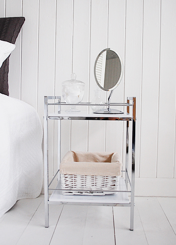 Shows the white and chrome bedside table as a small vanity area