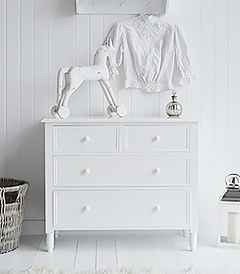New England white chest of drawers. Suits a simply designed large living room interior with the straight lines while giving plenty of storage