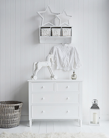 New England white chest of drawers, simple whire bedroom furniture for a New England styled home.