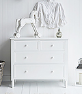 New England white chest of drawers. Suits a simply designed large hall interior with the straight lines while giving plenty of storage