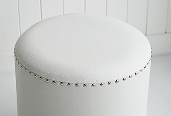 Photograph of the top of the round white dressing table stool to show the silver studding. The White Lighthouse bedroom furniture for coastal home interior