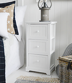 White bedside cabinet with three drawers from The Maine Range of white bedroom furniture