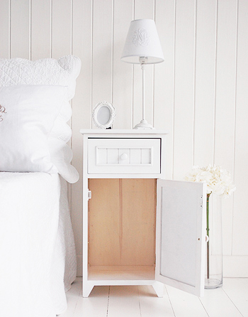 Shows the cupboard in the white Maine bedside cabinet