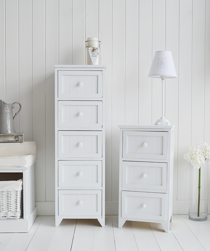Maine white bedroom furniture, showing the 5 drawer tall and the bedside table with 3 drawers