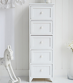 Maine white bedroom furniture 5 drawer chest of drawers. A tall narrow chest of drawers in bright white for all bedroom interiors